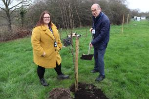 Basildon Council Technical Services Officer, Kathy Kramer and Councillor David Harrison planting one of the new fruit trees at Wickford allotments