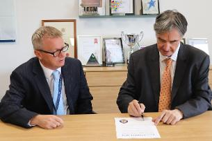 Chief Executive and Leader signing the Race at Work Charter - 19 August 2021