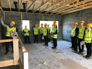 Photo of construction students from The Billericay School on site at Roman Way