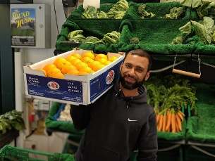 Fruit and vegetable trader celebrating launch of free wifi and contactless payments at Basildon market