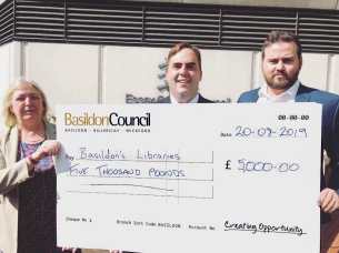 Photo of Councillor Kerry Smith, Deputy Leader and Councillor Gavin Callaghan, Leader of Basildon Council present a cheque for £5000 towards extra books for libraries to Councillor Susan Barker, Cabinet Member responsible for County Council Libraries