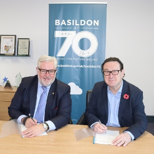 Decorative image showing Councillor Kevin Bentley, Essex County Council Cabinet Member for Infrastructure and Councillor Aidan McGurran, Chair of Basildon's External Affairs, Partnerships and Liaison Committee, signing the agreement