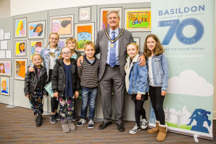 Images showing a photo of Basildon Arts Week Exhibition with Deputy Mayor of Basildon