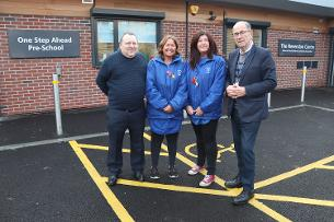 Decorative image showing Paul Heard (Chairman of the Wickford Community Association) Anne Badham, Donna Doyle (Co-managers of One Step Ahead pre-school) and Councillor David Harrison outside the new building