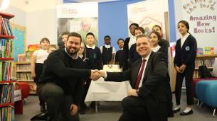 Decorative image showing Leader of Basildon Council Councillor Gavin Callaghan shaking hands with the Leader of Barking and Dagenham Council Councillor Darren Rodwell alongside pupils from Henry Green Primary School in Dagenham